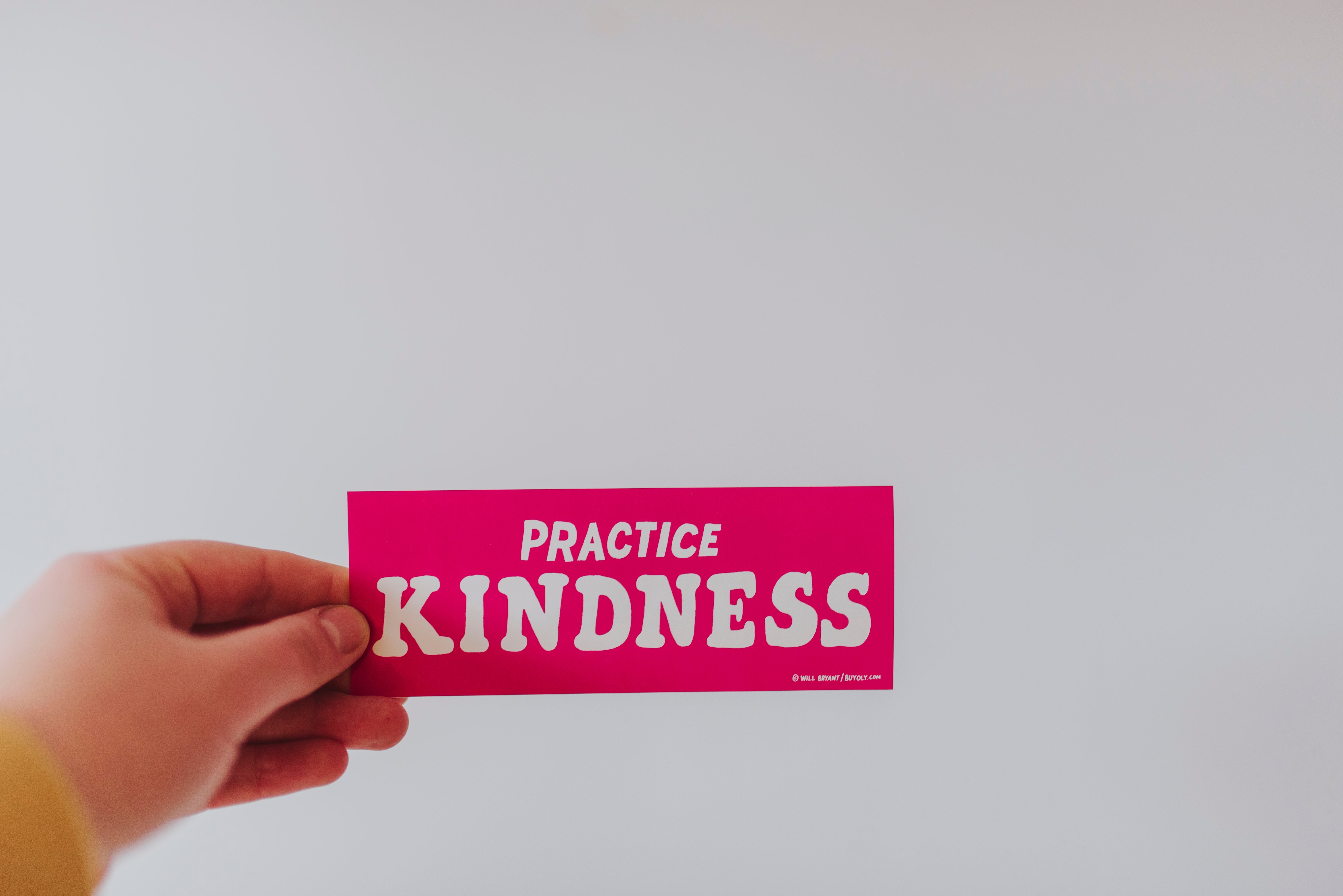 Person holding Kindness Sticker